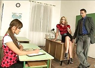 Lucky girl stands in classroom after lesson |