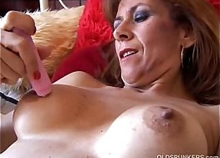 Very mature redhead makes no visible attempt to get stuffed |