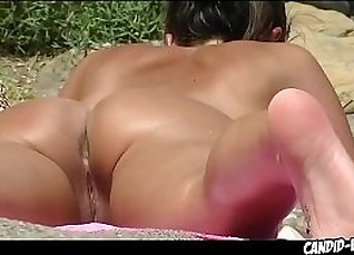 Super sexy milf stocking her pussy on the beach |