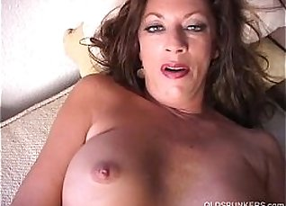 Crazy cougar strips and rubs her gorgeous pussy  