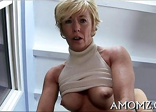 Horny blonde inserts pussy and rides it  