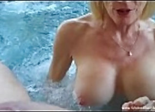 Busty granny sucking fake masseuses dick and watching  