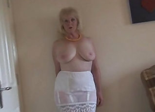 Busty Mature in silicone stocking |