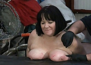Beautiful woman seen on large thick hanging vat being tortured by monster Prime Rod |