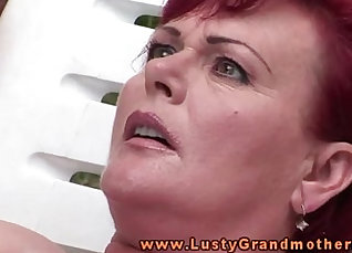 Blonde granny with large tits gets fingered outdoors |
