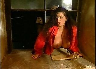 Blonde tgirl shows off her huge boobs |