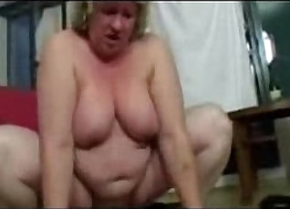 Amateur granny shows off her firm tits |