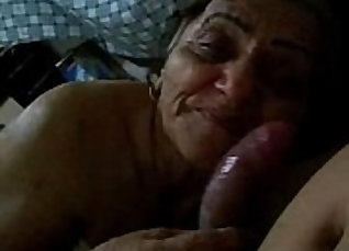 Curly-haired granny gives blowjob |