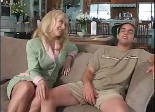 Brunette MILF seduces sons friend |