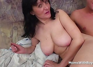 Busty mother enraps her son with several cocks  
