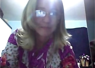 Blonde with glasses showing a webcam |
